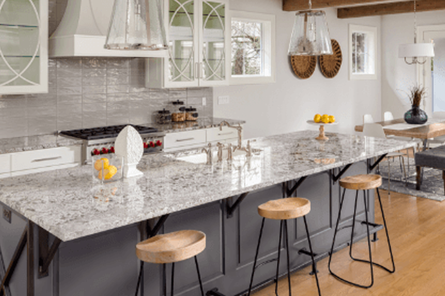light kitchen design with gold undertones and bench seats