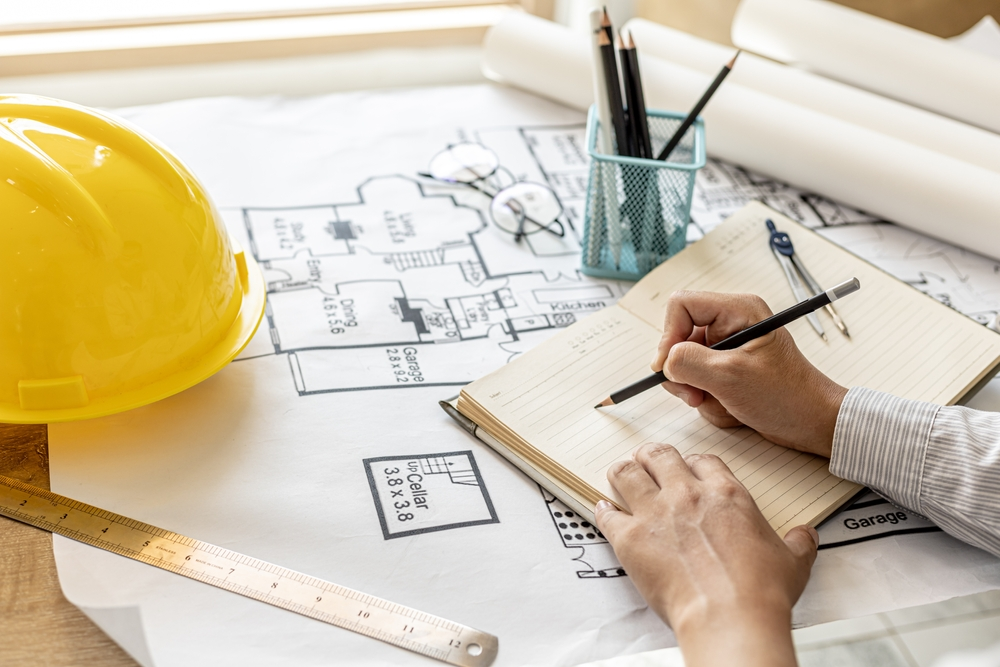 home addition contractor working on a design for client